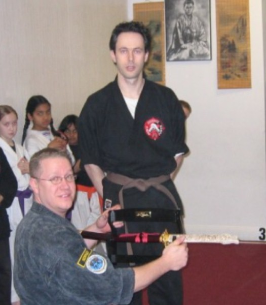 OMAR PRESENTS SENSEI WITH A SWORD